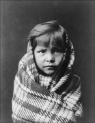 Old photo of a Navajo child wrapped in a blanket