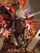 Native American dancer with a drum