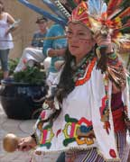 Native American dancer with a ceremonial rattle